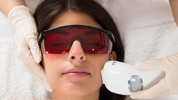 woman-receives-facial-laser-treatments